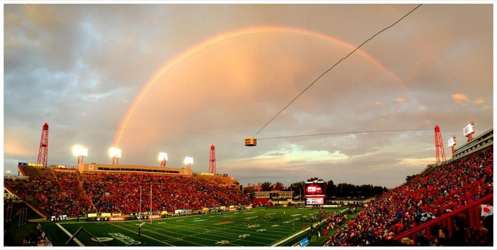 Sunny skies mixed with rain showers gave the visitors to McMahon a beautiful sight on Friday night as a rainbow arched over the packed stands.